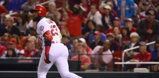 Marcell Ozuna watches a homer leave the yard. Credit: Jeff Curry, USA TODAY Sports.