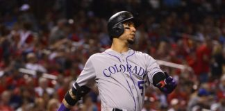 Carlos Gonzalez struts his stuff as he crushed the home run in the seventh. Credit: Jeff Curry, USA TODAY Sports.