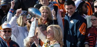Denver Broncos owners wife Annabel Bowlen lifts the Vince Lombardi Trophy during the Super Bowl 50 championship parade celebration at Civic Center Park.