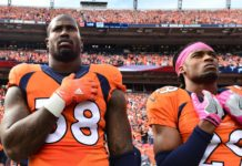 Von Miller and Bradley Roby stand for the Anthem in 2016. Credit: Ron Chenoy, USA Today Sports.