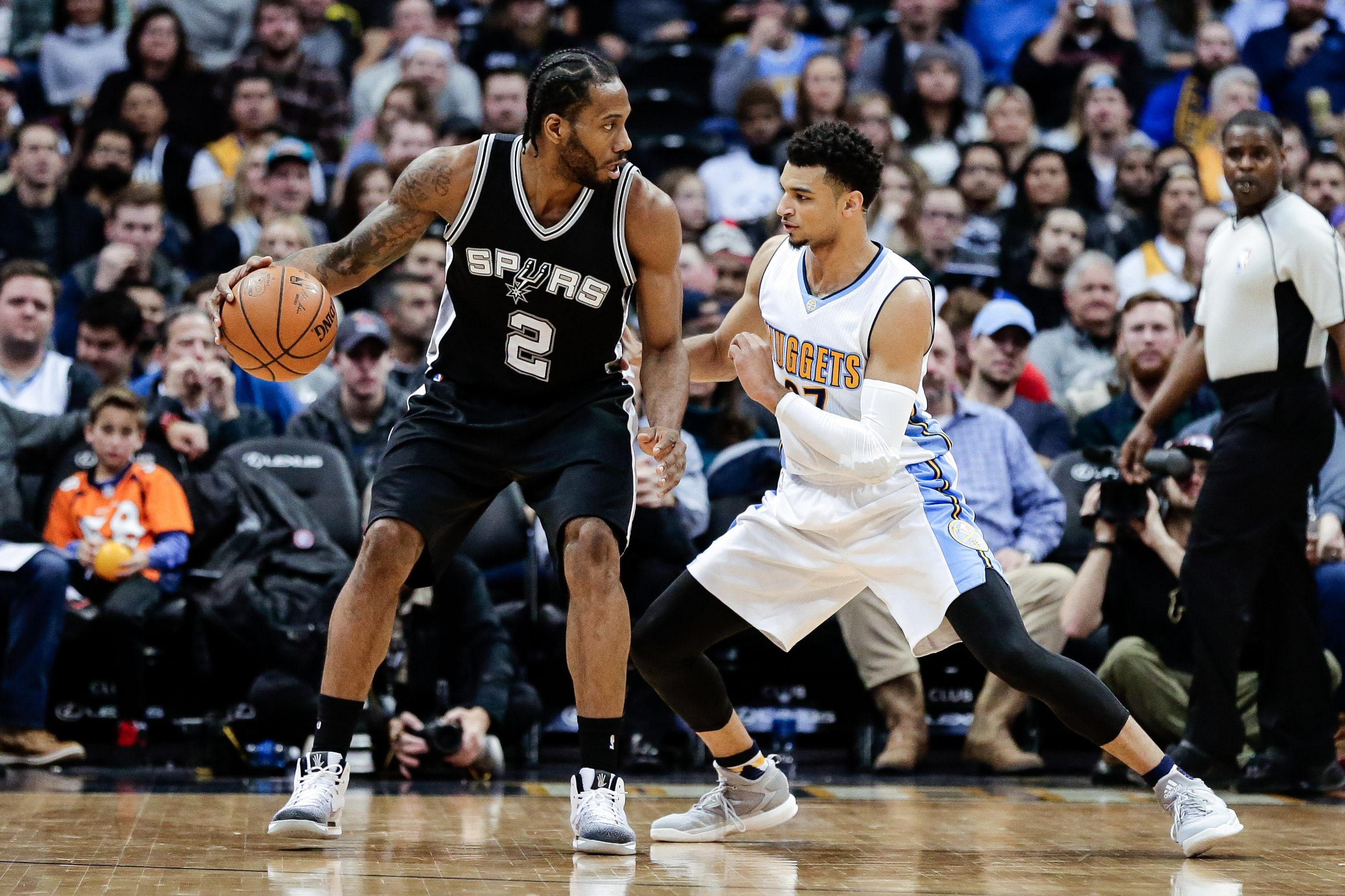 Denver Nuggets guard Jamal Murray (27) guards San Antonio Spurs forward Kawhi Leonard (2) in the fourth quarter at the Pepsi Center. The Spurs won 127-99.