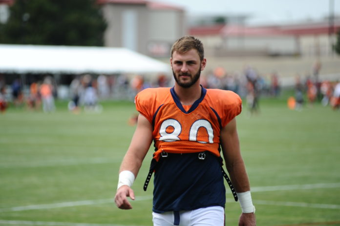 Denver Broncos tight end (TE) Jake Butt walks off the field after practice at UC Health Training Center.