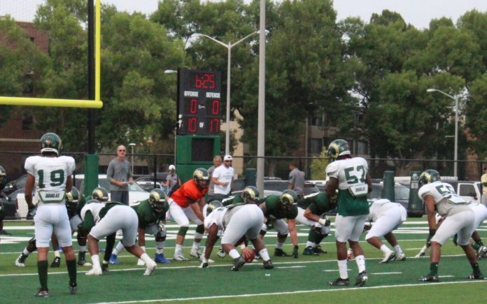 K.J. Carta-Samuels and the first-team offense against the first-team defense on Aug. 2 in practice. Credit: Rich Kurtzman.