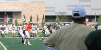 Mike Bobo watches K.J. Carta-Samuels and his Rams practice on Aug. 2. Credit: Rich Kurtzman