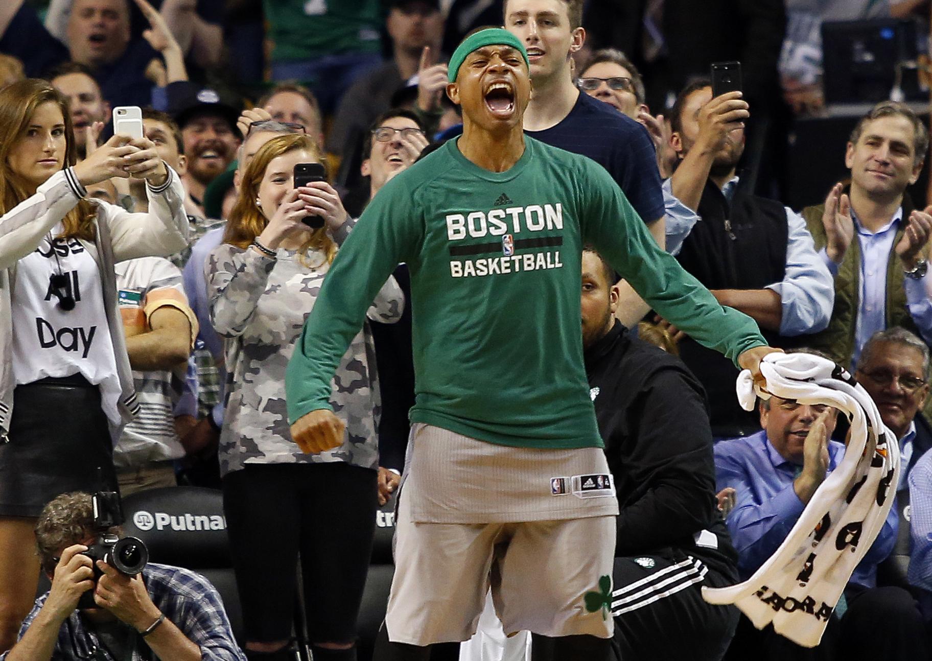 Boston Celtics guard Isaiah Thomas (4) celebrates in the final moments of the Boston Celtics 112-94 win over the Milwaukee Bucks at TD Garden.