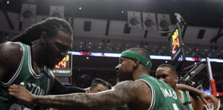 Boston Celtics guard Isaiah Thomas (4) talks with his teammates after forward Jae Crowder (99) was fouled by the Chicago Bulls during the second half in game six of the first round of the 2017 NBA Playoffs at United Center. The Celtics defeated the Bulls.