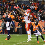 Denver Broncos defensive back Jamal Carter (20) blocks a pass intended for Kansas City Chiefs tight end Demetrius Harris (84) in the fourth quarter at Sports Authority Field at Mile High