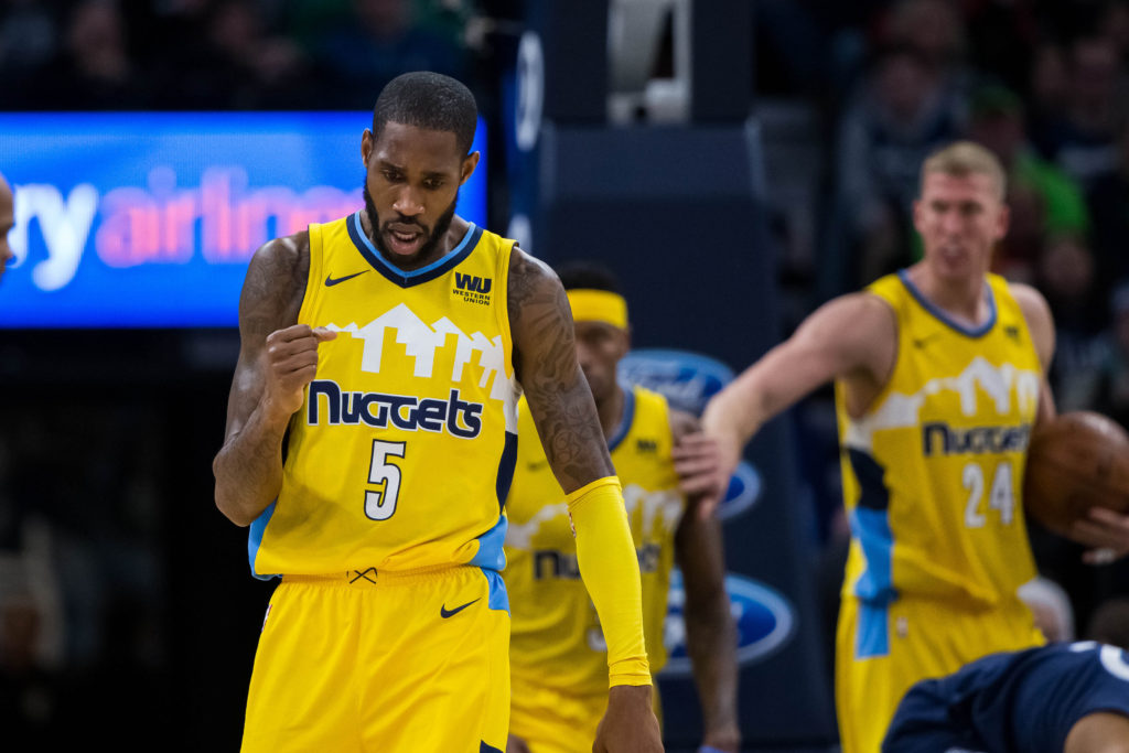 Denver Nuggets guard Will Barton (5) celebrates his basket in the fourth quarter against the Minnesota Timberwolves at Target Center.