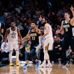 Utah Jazz guard Donovan Mitchell (45) and guard Ricky Rubio (3) look to referee Ray Acosta (54) as Denver Nuggets guard Jamal Murray (27) and center Nikola Jokic (15) and guard Gary Harris (14) motion in the third quarter at the Pepsi Center.