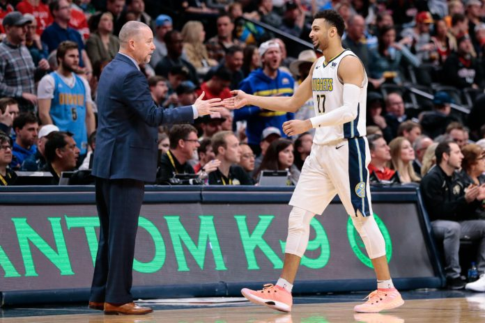 Denver Nuggets head coach Michael Malone and guard Jamal Murray (27) in the fourth quarter against the Houston Rockets at the Pepsi Center.