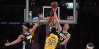 ;Los Angeles Lakers forward Julius Randle (30) is defended by Denver Nuggets center Mason Plumlee (24) and forward Trey Lyles (7) in the first half during an NBA basketball game at Staples Center.