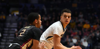 Missouri Tigers forward Michael Porter Jr. (13) controls the ball against Florida State Seminoles guard CJ Walker during the first half in the first round of the 2018 NCAA Tournament at Bridgestone Arena.