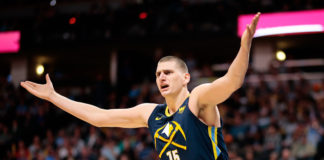 Denver Nuggets center Nikola Jokic (15) reacts after a play in the first quarter against the Minnesota Timberwolves at the Pepsi Center.