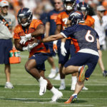 Denver Broncos quarterback Chad Kelly (6) hands the ball off to running back Royce Freeman (37) during drills on the first day of training camp at Paul D. Bowlen Memorial Broncos Centre.