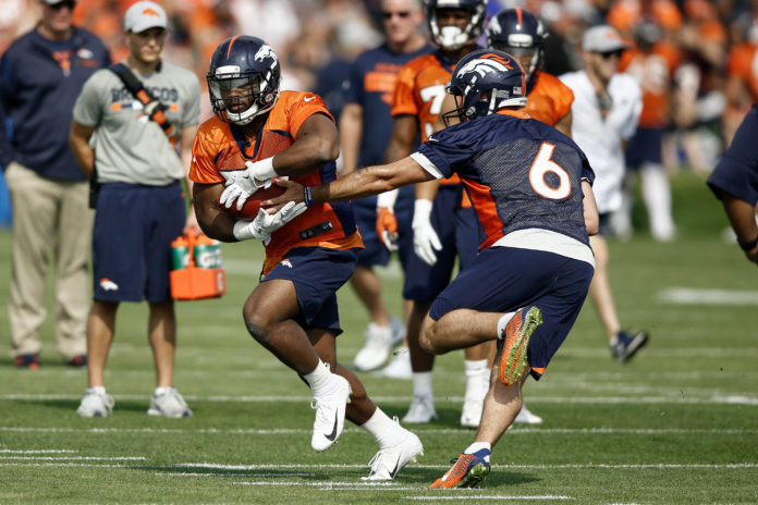 Denver Broncos Quarterback Chad Kelly 6 Hands The Ball Off To Running Back Royce