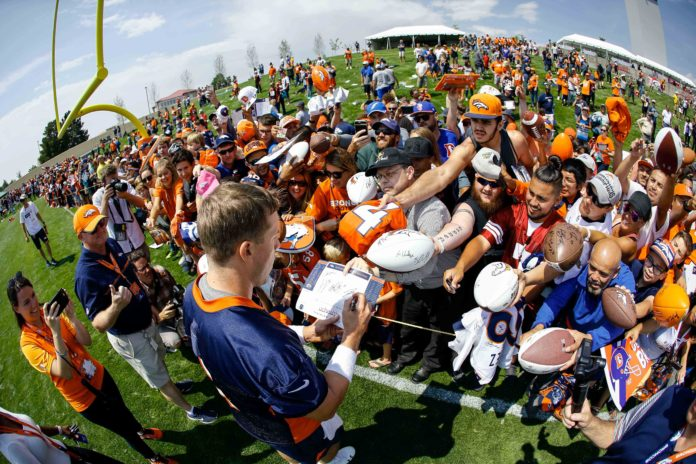Denver Broncos quarterback Case Keenum (4) signs autographs after morning practice on the first day of training camp at UCHealth Training Center.