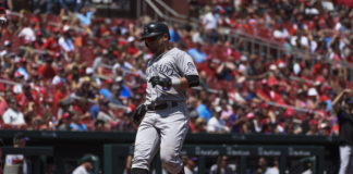 Colorado Rockies left fielder Gerardo Parra (8) scores a run against the St. Louis Cardinals during the fourth inning at Busch Stadium.