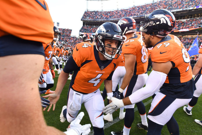 Denver Broncos quarterback Case Keenum (4) before the game against the Minnesota Vikings in the first quarter at Broncos Stadium at Mile High.