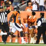 Denver Broncos wide receiver Isaiah McKenzie (16) returns a 78 yard punt return for a touchdown in the second against the Minnesota Vikings quarter at Broncos Stadium at Mile High.