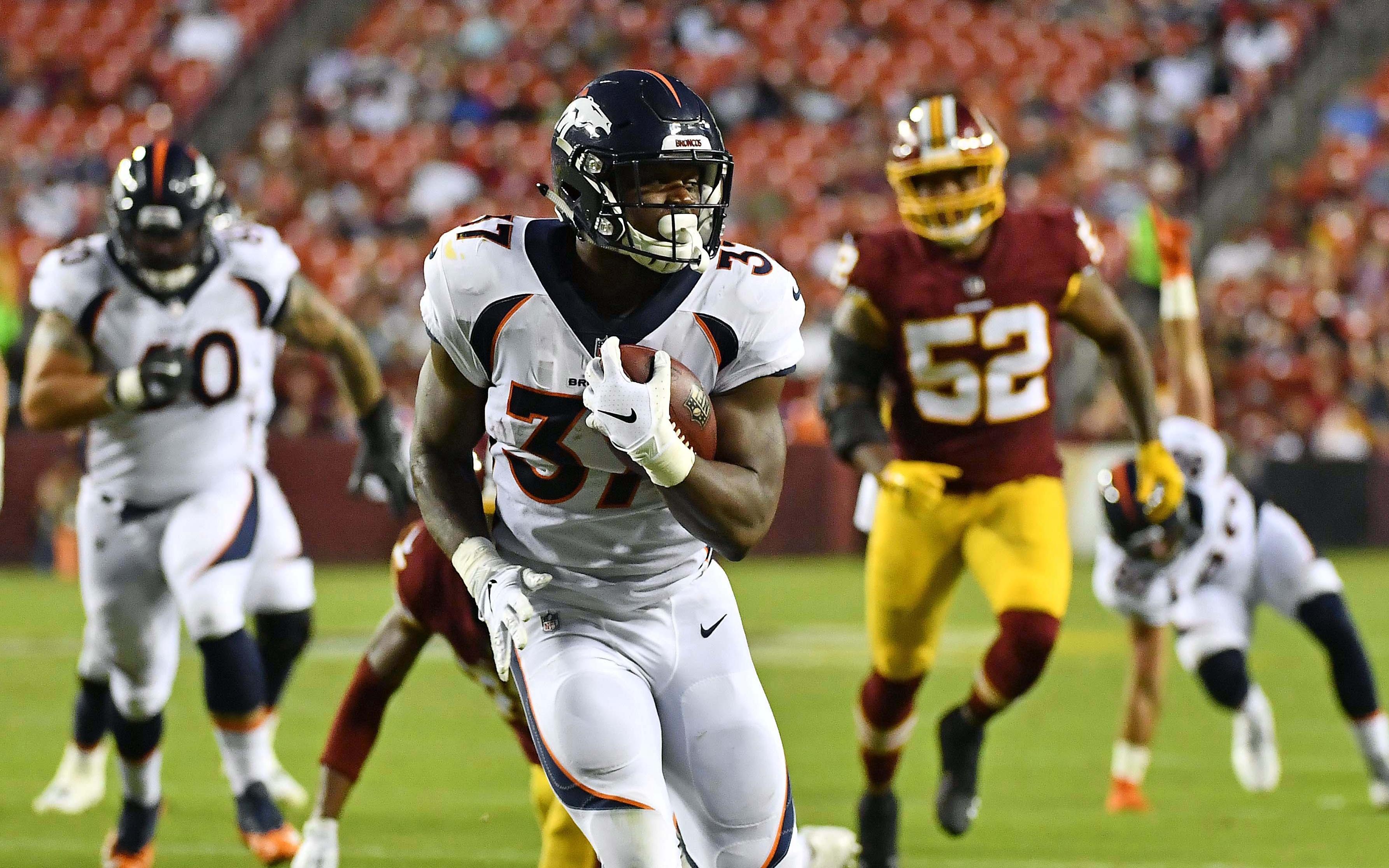 Royce Freeman runs for a touchdown against Washington. Credit: Brad Mills, USA TODAY Sports.