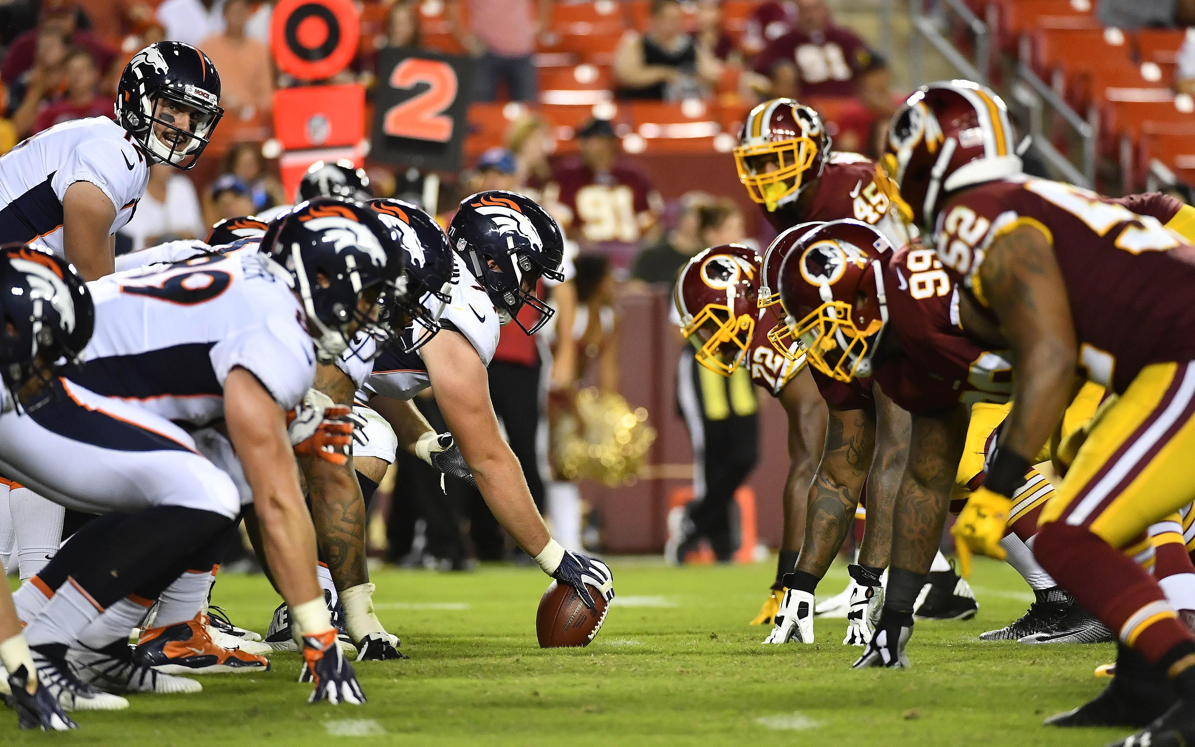 Broncos offensive line, Redskins defensive line. Credit: Brad Mills, USA TODAY Sports.