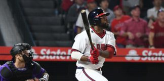 Eric Young hits a clutch two-run single. Credit: Richard Mackson, USA TODAY Sports.