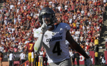 Colorado Buffaloes wide receiver Bryce Bobo (4) celebrates after scoring on a 10-yard touchdown pass in the fourth quarter against the USC Trojans during a NCAA football game at Los Angeles Memorial Coliseum. USC defeated Colorado 21-17.