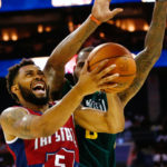 Tri State player Xavier Silas (5) goes up for a shot against Ball Hogs player Rasual Butler (8) at Spectrum Center.
