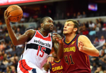 Washington Wizards guard Donald Sloan (15) drives to the basket as Cleveland Cavaliers forward Ante Zizic (41) defends during the second half at Capital One Arena.