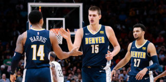 Denver Nuggets guard Gary Harris (14) and center Nikola Jokic (15) and guard Jamal Murray (27) in the third quarter against the New Orleans Pelicans at the Pepsi Center.
