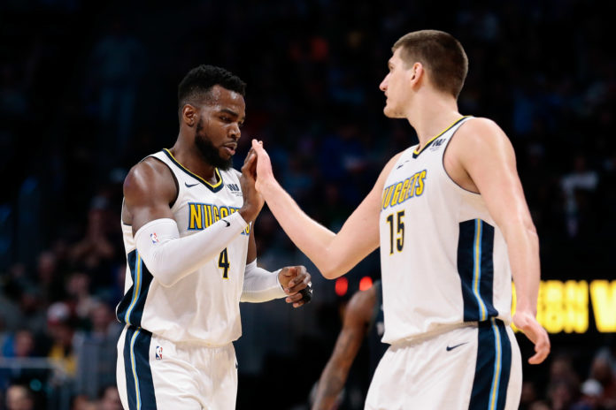 Denver Nuggets forward Paul Millsap (4) reacts with center Nikola Jokic (15) in the third quarter against the Detroit Pistons