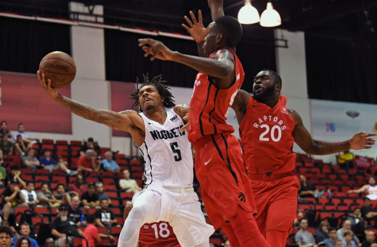 Denver Nuggets guard DeVaughn Akoon-Purcell (5) shoots against Toronto Raptors forward Chris Boucher (25) during the second half at Cox Pavilion.