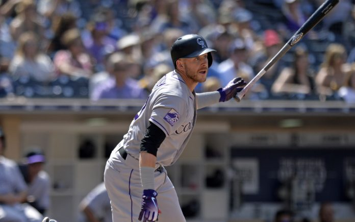 Trevor Story hits a double. Credit: Jake Roth, USA Today Sports.