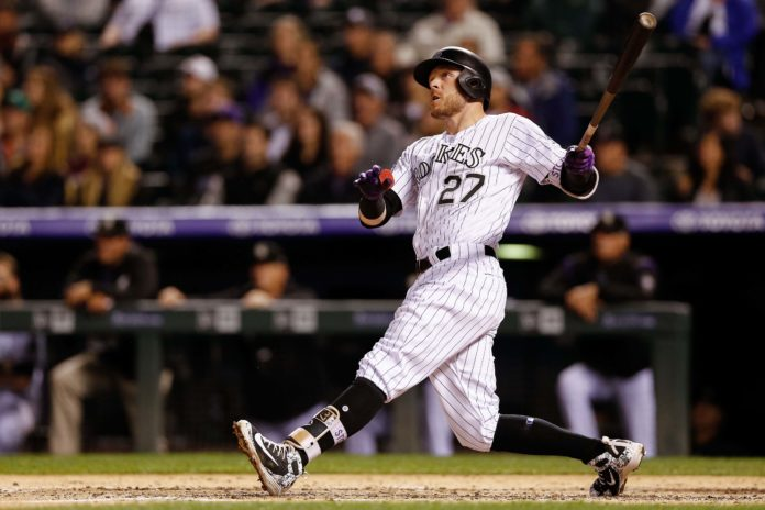 Colorado Rockies shortstop Trevor Story (27) watches his ball on a solo home run in the fourth inning against the San Francisco Giants at Coors Field.