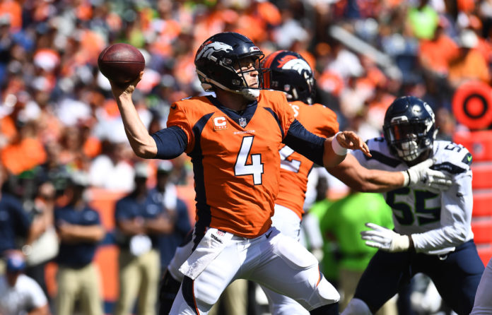Denver Broncos quarterback Case Keenum (4) attempts a pass in the first quarter against the Seattle Seahawks at Broncos Stadium at Mile High.