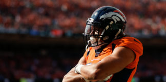 Denver Broncos running back Phillip Lindsay (30) celebrates after scoring a touchdown in the first quarter against the Seattle Seahawks at Broncos Stadium at Mile High.