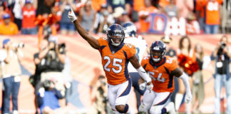 Denver Broncos cornerback Chris Harris Jr. (25) celebrates after a play in the fourth quarter against the Seattle Seahawks at Broncos Stadium at Mile High.