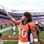 Denver Broncos running back Phillip Lindsay (30) celebrates the win over the Oakland Raiders at Broncos Stadium at Mile High.