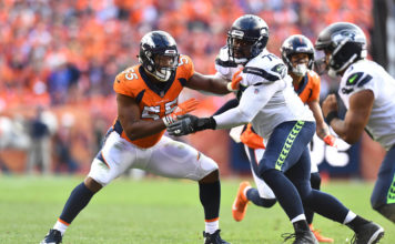 Denver Broncos outside linebacker Bradley Chubb (55) pass rushes on Seattle Seahawks center Ethan Pocic (77) in the fourth quarter at Broncos Stadium at Mile High.
