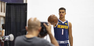 Denver Nuggets forward Michael Porter Jr. (1) has his picture taken by Denver Post photographer AAron Ontiveroz during media day at the Pepsi Center.