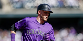 Colorado Rockies shortstop Trevor Story (27) rounds the bases on a solo home run in the second inning against the Philadelphia Phillies at Coors Field.