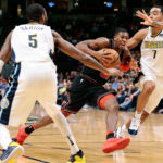 Denver Nuggets guard Will Barton (5) and forward Trey Lyles (7) defend against Chicago Bulls guard Kris Dunn (32) in the fourth quarter at the Pepsi Center.