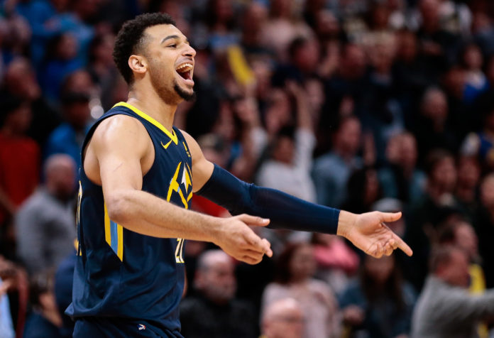 Denver Nuggets guard Jamal Murray (27) celebrates in the fourth quarter against the Golden State Warriors at the Pepsi Center.