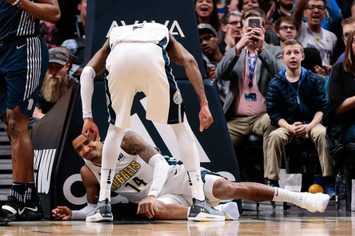 Denver Nuggets guard Gary Harris (14) reacts on the floor after a play in the fourth quarter against the Detroit Pistons at the Pepsi Center.
