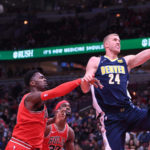 Chicago Bulls forward Bobby Portis (5) fouls Denver Nuggets center Mason Plumlee (24) during the second half at the United Center