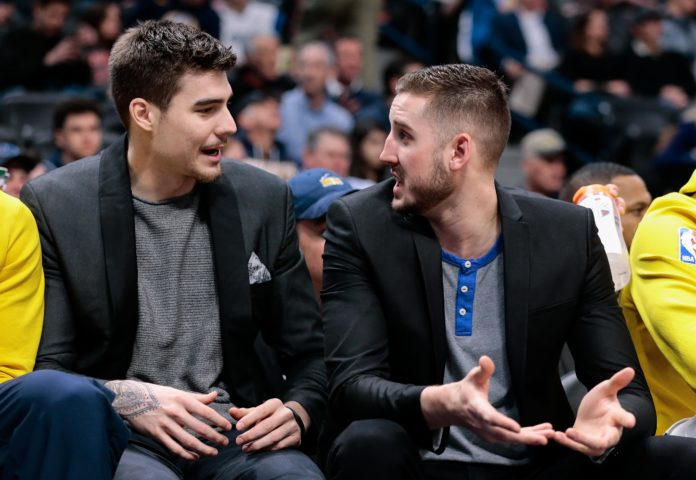 Denver Nuggets forward Juancho Hernangomez (L) talks with forward Tyler Lydon (R) in the second quarter against the Dallas Mavericks at the Pepsi Center.