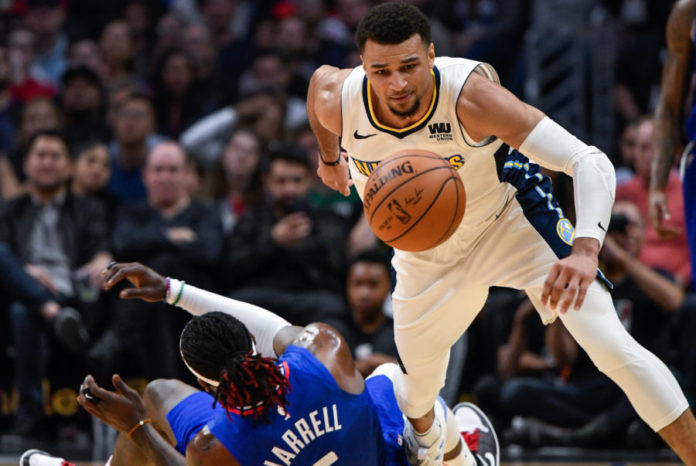 LA Clippers forward Montrezl Harrell (5) and Denver Nuggets guard Jamal Murray (27) chase down a loose ball during the second half at Staples Center