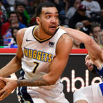 Denver Nuggets forward Trey Lyles (7) and LA Clippers guard Austin Rivers (right) go to the floor for a loose ball during the fourth quarter at Staples Center. The Nuggets went on to a 134-115 win