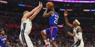 LA Clippers guard Lou Williams (23) drives to the basket between Denver Nuggets center Mason Plumlee (24) and guard Torrey Craig (3) during the first half at Staples Center
