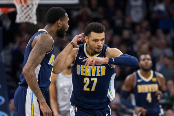 Denver Nuggets guard Jamal Murray (27) celebrates his basket in the fourth quarter against Minnesota Timberwolves at Target Center.
